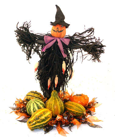 Halloween centerpiece in bright colors with scarecrow. photo