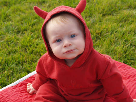 Eight month old child in a devil costume. Stock Photo - 556272