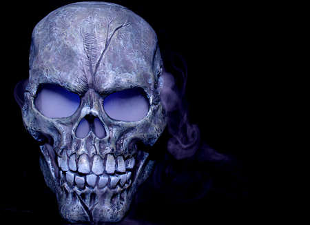 A Halloween prop skull with fog coming from it's eyes and nose.