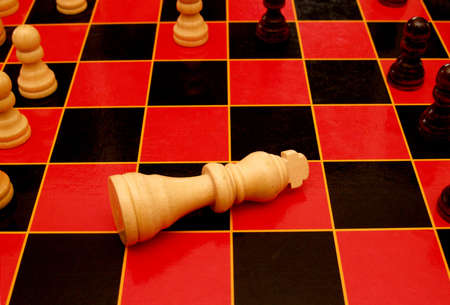 King piece on a chess board in the draw position.