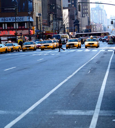 A street with a long line of taxis in New York.
