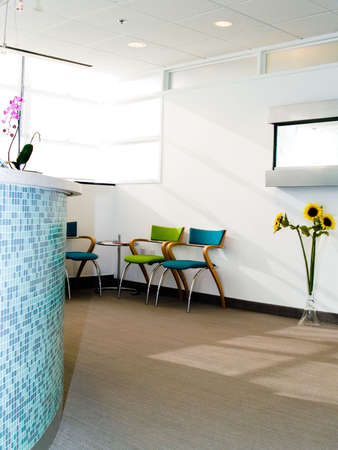 Waiting room with reception desk in blue tile Stock Photo