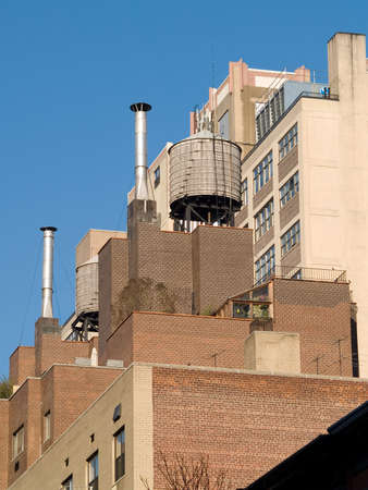 Rain water tower on top of a New York City apartment building.