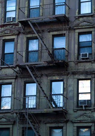frontage: Windows and escape ladders on a New York apartment building. Stock Photo