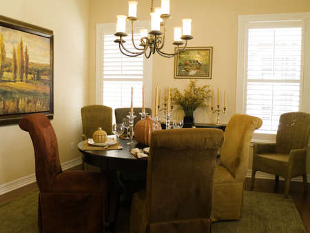 Very attractive dining room with fall table setting. photo