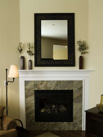 Fireplace and mantel with mirror