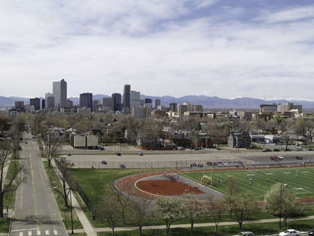denver co: Downtown, Denver, CO buildings as viewed from east to west from Denvers East High School.  All eyes will be on Denver, Colorado for next years Democratic National Convention. Stock Photo