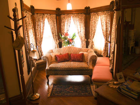 sitting area: Antique furniture displayed in a sitting area of a bedroom.  Victorian style. Stock Photo