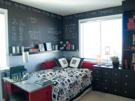 luxury bedroom: Funky bedroom with chalk board walls. Stock Photo