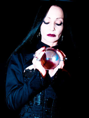scrying: woman with crystal ball