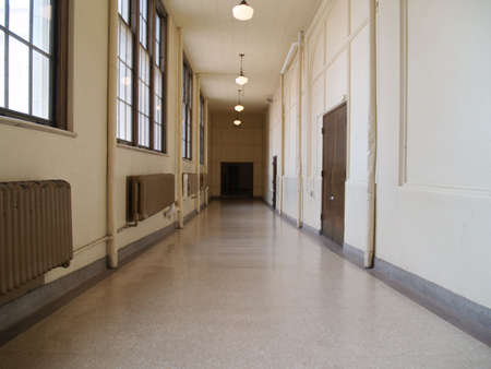 A long hallway of an old high school