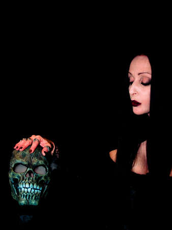 Spooky lady with a spooky skull Stock Photo - 1237318