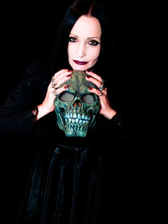 Spooky lady with a spooky skull photo