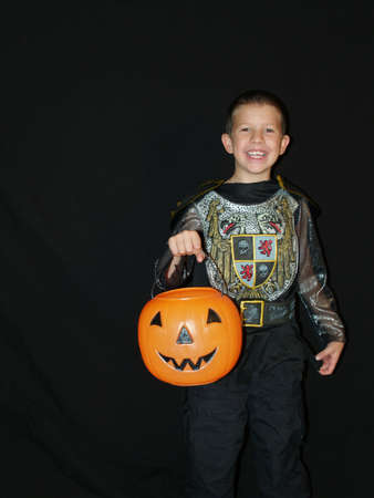 teats: A little boy in a halloween costume trick or teats