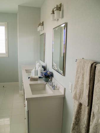cor: Duel sinks in a pretty, modern bathroom