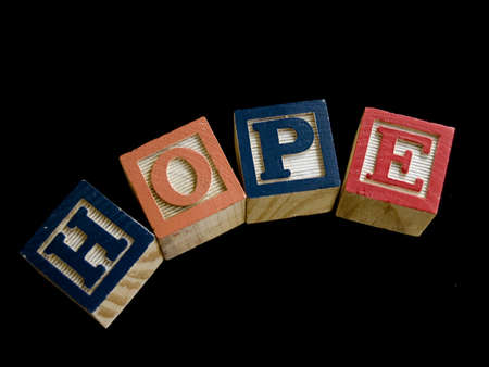 The word hope spelled out in children's toy blocks Stock Photo - 8592738