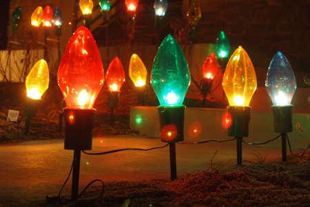 Giant Christmas bulbs lighting a walkway during the Christmas season. Stock Photo - 10331423