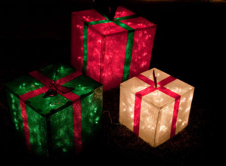 Red, green, and white lighted gift boxes for Christmas Stock Photo