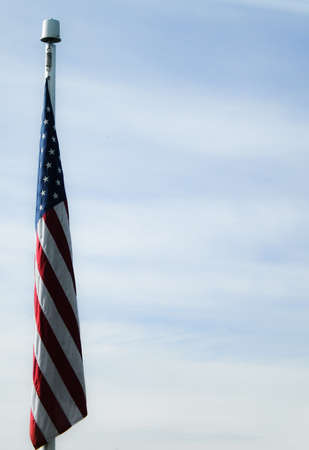 no movement: The Flag of the United States of America, hanging in a calm sky. Stock Photo