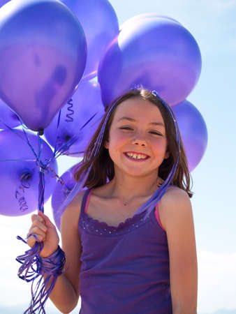 Pretty little girl with baloons in hand photo