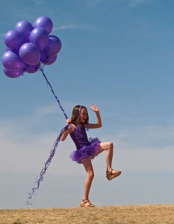 baloons: Pretty little girl with baloons in hand