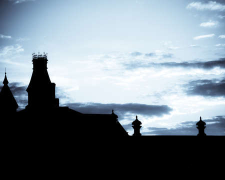 Blue toned sunset over spires of old buildings Stock Photo