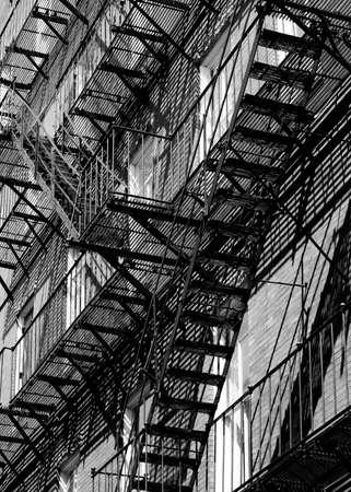 escape: Confusing fire escape in black and white Stock Photo
