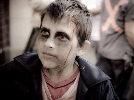 Zombie kid looking rather dead Stock Photo