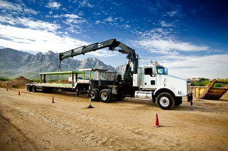 work load: Truck Mounted Crane Trench Shoring Equipment Stock Photo