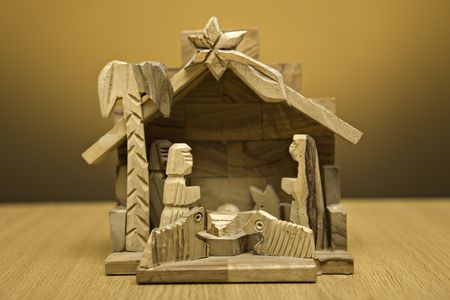 wooden nativity christmas decoration on orange background photo