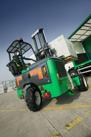 Moffett Truck Mounted Forklift in opperation at depot photo