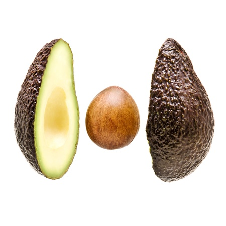 avacado: avacado sliced on white background with stone in centre