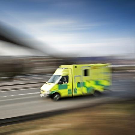 ambulance emergency response speeding along the motorway photo