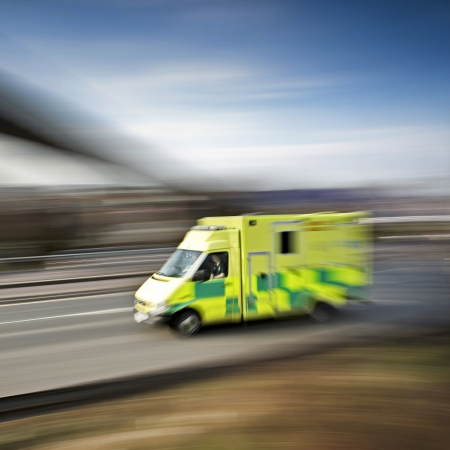 first responder: ambulance emergency response speeding along the motorway Stock Photo