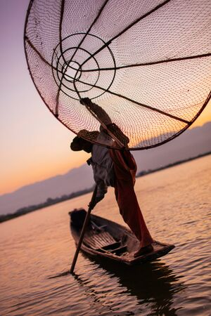 inle: A Traditional Leg Rowing Fisherman of Inle Lake, Myanmar Burma