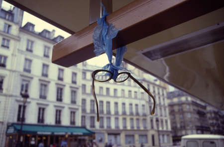 Paris, France, 1985 - Glasses found and hanging of a busstop in Paris