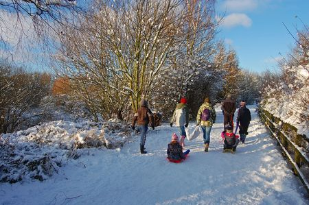 Evocative scene of a family group at ChriistmasXmas returning home after a day of fun in the snow photo