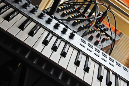 keyboard and mixer in a home studio environment photo