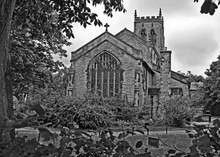 churchyard: English country church in black and white