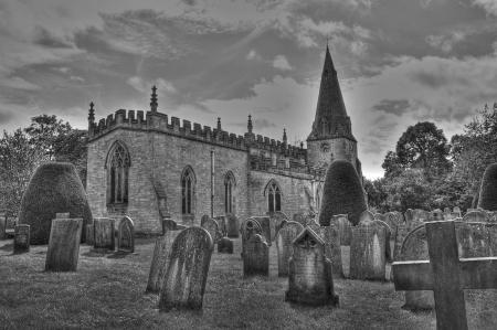 churchyard: Typical British churchyard in black and white