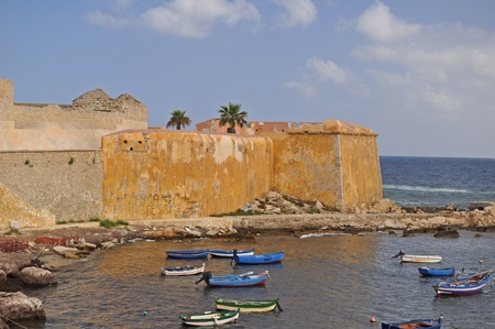 Fishing boats by the old walls of Trapani