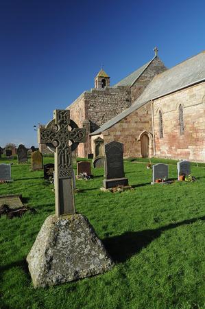 gaelic: Celtic Cross In the graveyard on Lindisfarne in the UK