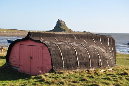 spirits: traditional Boat Shed on Lindisfarne, the main island in the Farne islands group in the UK