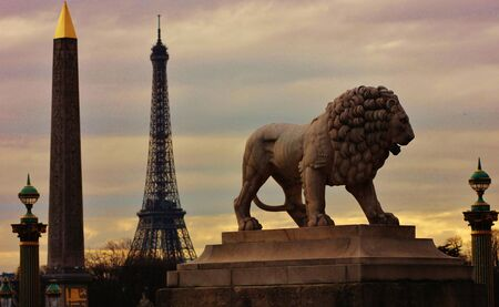 Place de la Concorde in Paris with the Eiffel Tower and the obelisk in the foreground with the statue of a lion