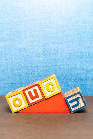 'Ouch' spelt in coloured children' blocks with a sky blue background 版權商用圖片