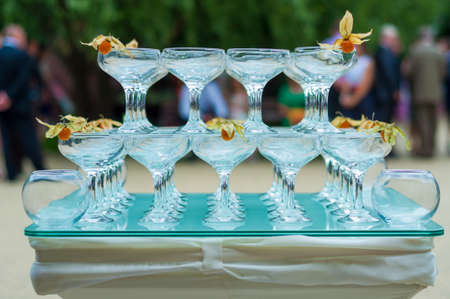 pyramid of glasses on a cocktail table photo