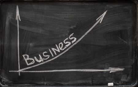 buzz word: writing on the blackboard business graph close-up