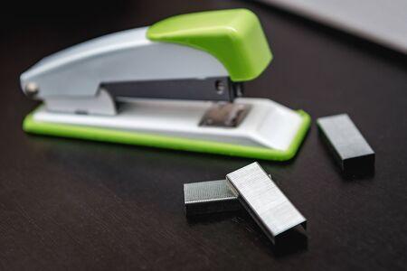 stapler, stapler pins, grey background