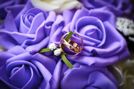 Wedding ring,engagement ring,Couple rings,Diamond ring,White bokeh,Purple background