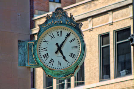 Business Clock Mounted On The Side Of A Building